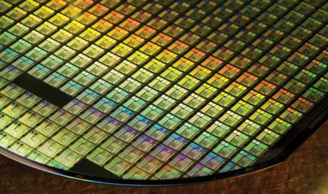TSMC unveiled Wafer-on-Wafer (WoW) chip manufacturing technology at its TSMC 2018 Technology Symposium, an annual conference which was held in Santa Clara this year. (Image courtesy of TSMC.)