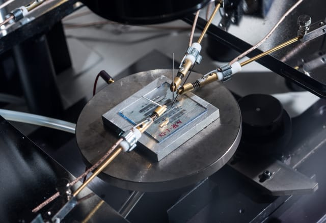 Image shows organic-thin film transistors with a nanostructured gate dielectric under continuous testing on a probe station. (Image courtesy of Rob Felt/Georgia Tech.)