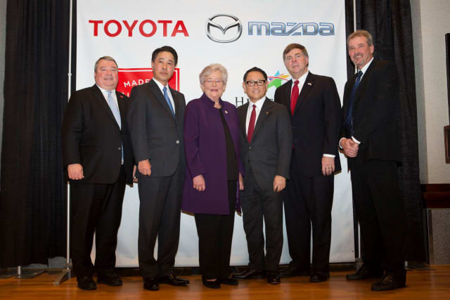 Following today's press conference, the speakers joined together to celebrate the announcement (left to right): Secretary Greg Canfield, Mazda Motor Corporation President and Chief Executive Officer Masamichi Kogai, Alabama Govornor Kay Ivey, Toyota Motor Corporation President Akio Toyoda, Huntsville Mayor Tommy Battle, Commission Chairman Mark Yarbrough. (Image courtesy of Toyota.)