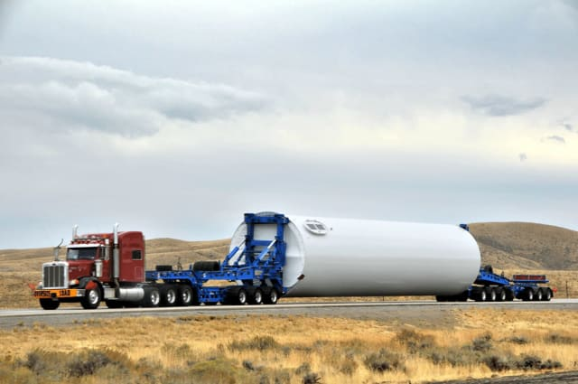 Transporting heavy materials for wind turbines can be a delicate challenge. (Image courtesy of 3D Printing Industry.)