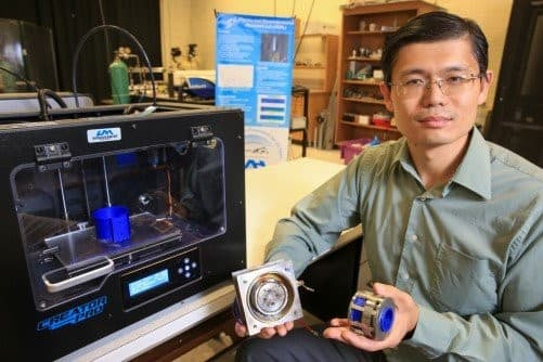 Dr. Xu holds a prototype of the thruster made using 3-D printed parts. (Image courtesy of UAH.)