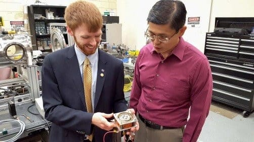 Ethan Hopping and Dr. Gabe Xu partnered to design and test a Hall-effect thruster with a 3-D printed channel and propellant distributor. (Image courtesy of UAH.)