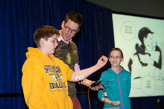 Neuroscientist Greg Gage from Backyard Brains leads a demonstration on neuroscience. (Image courtesy of USA Science and Engineering Festival.)