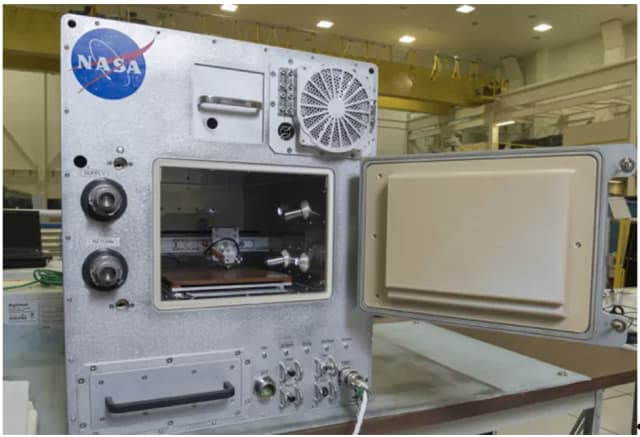 The mini fridge-sized Refabricator is capable of recycling and 3D printing with space-grade ULTEM plastic. (Image courtesy of NASA/MSFC/Emmett Given.)
