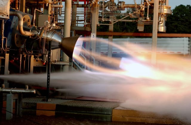 Aerojet Rocketdyne completed a hot-fire test of its MPS-120 CubeSat High-Impulse Adaptable Modular Propulsion System (CHAMPS), the first 3D-printed hydrazine integrated propulsion system, in 2014.