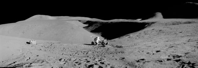 Figure 7: Panorama view of Apollo 15 lunar surface photos south of Station 2 taken by lunar module pilot James B. Irwin. Astronaut David R. Scott, mission commander, performs a task at the Lunar Roving Vehicle parked on the edge of Hadley Rille (Rima Hadley) during the first moonwalk mission. (Image courtesy of NASA.)