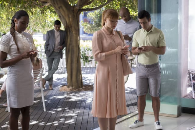 Black Mirror, Series 3, Episode 1: Lacie (Bryce Dallas Howard) is seen standing amidst a crowd, all glued to their cell phones in a world where social credit ratings determine every aspect of your life.