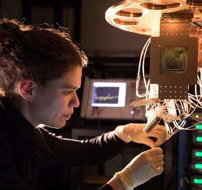 Research Scientist Marissa Giustina installs a Google Bristlecone chip at the Quantum AI Lab in Santa Barbara, CA. (Image courtesy of Google.)