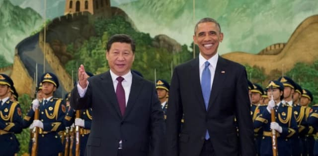 Chinese President Xi Jinping welcomes President Obama to a ceremony in the Great Hall of the People in 2014.