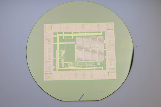 This thin-film electronic circuit can peel easily from its silicon wafer with water, making the wafer reusable for building a nearly infinite number of circuits. (Image courtesy of Purdue University/Chi Hwan Lee.)
