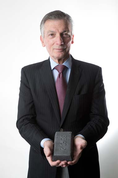 Boston Metal co-founder Donald Sadoway holds a bar of steel made with his company's electrolytic cell. (Source: Boston Metal.)