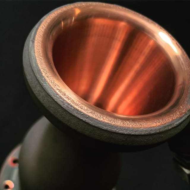 Polished bi-metal rocket engine, 3D-printed using a copper-chromium-zirconium alloy on an EOS M290 metal 3D printer.   (Image courtesy of Launcher.)