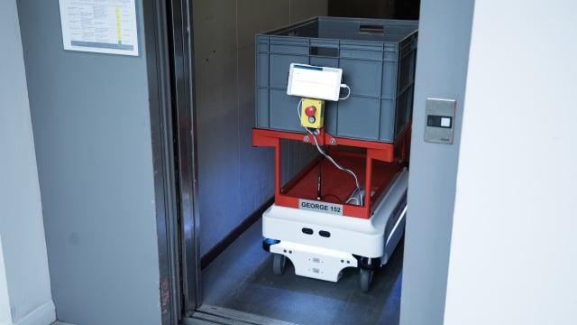 MiR AGV taking an elevator. (Image courtesy of Honeywell)