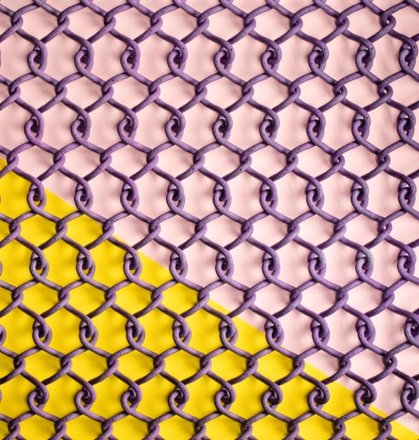 A chain-link design that is printed as a single twisted unit and can compress and expand. The print has been dyed purple. (Image courtesy of HP.)