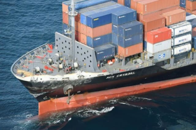 The 730-foot ACX Crystal was carrying more than 1000 shipping containers when it collided with the guided-missile destroyer USS Fitzgerald 56 miles off the coast of Japan on June 17th. (Image courtesy of Kyodo Photo.)