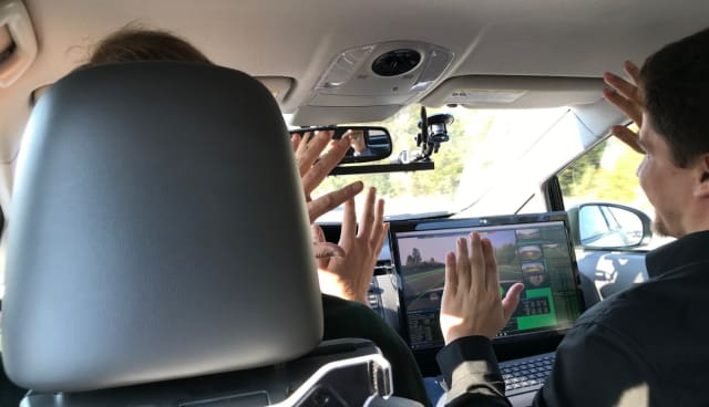 Look, no hands. An AImotive-equipped autonomous vehicle drives itself 65 mph on California's crowded US101 south of San Francisco.