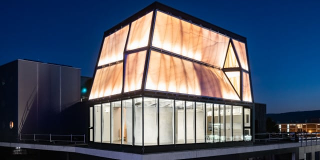 DFAB House at night. The house is built on top of the Next Evolution in Sustainable Tech building. (Image courtesy of Roman Keller/ ETH Zurich.)