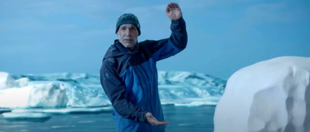 Veteran explorer Mike Horn shows how thick the Arctic ice was 15 years ago. It was reduced to a few centimeters on his last expedition. (Picture from video, courtesy of Dassault Systèmes.)