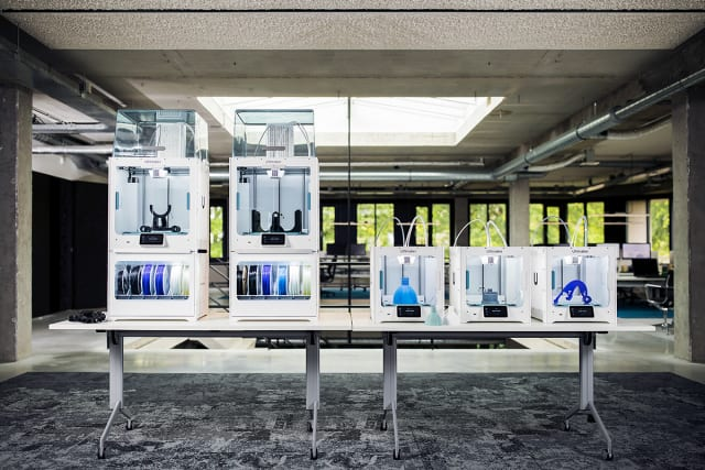 The Ultimaker S5 Pro Bundle alongside Ultimaker S3 3D printers. (Image courtesy of Ultimaker.)