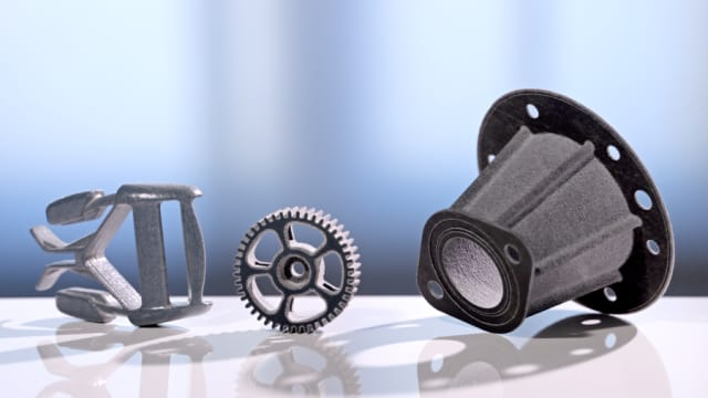 A buckle part, automotive gear and pipe fitting made with HSS. (Image courtesy of Loughborough University.)