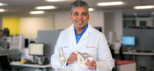 Head of Johnson & Johnson's 3D Printing Center of Excellence, Sam Onukuri, holding a patient-specific, 3D-printed implant. (Image courtesy of Johnson & Johnson.)