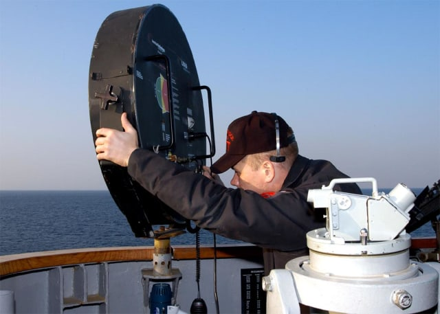Figure 1 - Ship's Serviceman 1st Class Scott D. Amberger aims a long range acoustic device (LRAD) at an incoming small craft from the amphibious command ship USS Blue Ridge (LCC-19) during a small boat attack drill. (Image courtesy of the US Navy.)