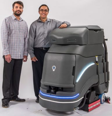 Avidbots founders, from left, Faizan Sheikh and Pablo Molina with Neo, a commercial floor-cleaning robot. (Image courtesy of Avidbots.)