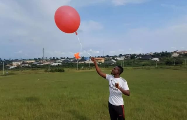 Kanda weather balloon being launched by a West African local. These balloons are capable of recording climate data, which will be transmitted and stored through the Telos blockchain. (Photo courtesy of Kanda.)
