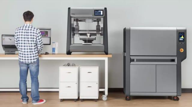 Figure 1. You're gonna need a big desktop. The Desktop Metal Studio system printer on a desk—and next to a desk. (Image courtesy of Desktop Metal.)