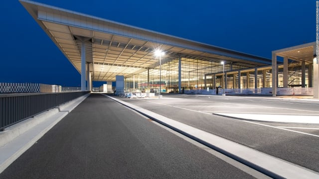Berlin's Brandenburg Airport awaits its first flight since its first planned opening in 2012. The lights stay on because no one has found the light switches. (Image courtesy of CNN.)