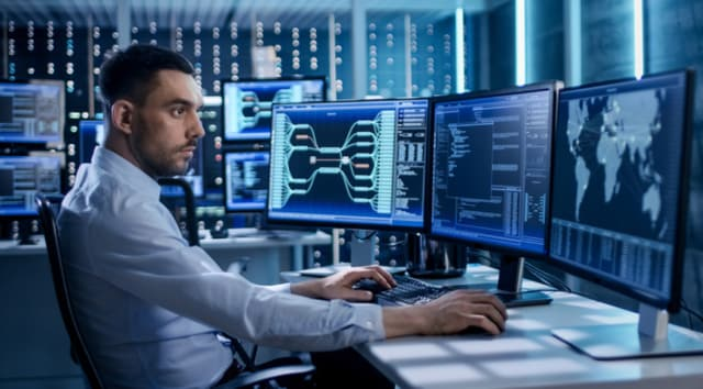A BAE Systems system security specialist seeks out cyberthreats. The company will be developing new technologies to help detect and resolve hidden threats in real time for DARPA. (Image courtesy of BAE Systems.)