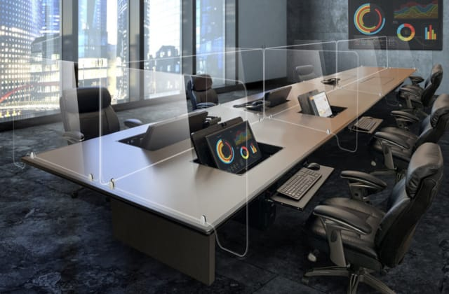 Fixed or movable barriers, along with maintaining social distancing guidelines, will likely be included in new office layouts. (Image courtesy of SMARTdesks.)