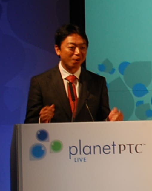 Hiroaki Kuwahara, president of PTC Japan, welcomes attendees to PlanetPTC Live in this 2010 photo. (Image courtesy of PTC.)