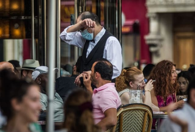 Feeling something coming on? Crowds gather at a Paris café on June 2, seemingly unaware ofor unconcerned about a COVID-19 pandemic that has not yet passed. (Image courtesy of the Wall Street Journal.)