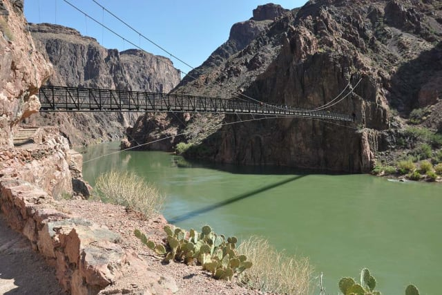 Don't let its delicate appearance fool you: the Kaibab Bridge has been standing since 1928, and still welcomes tens of thousands of visitors every year. (Image courtesy of Grand Canyon Explorer.)