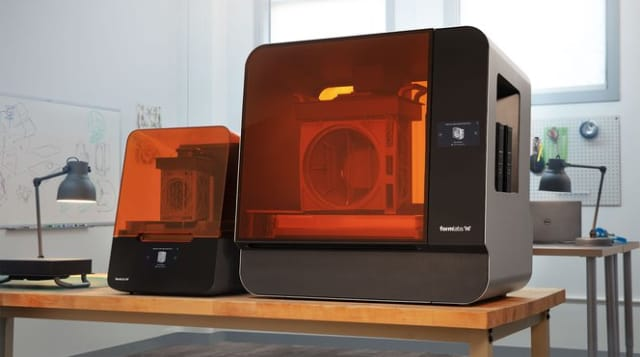 On the left, the Form 3. On the right, the Form 3L. (Image courtesy of Formlabs.)