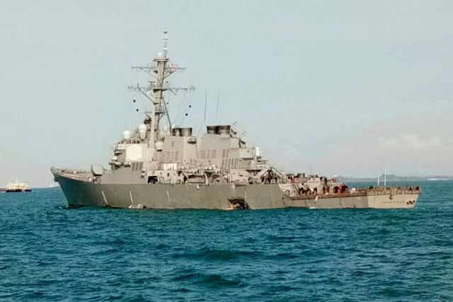 When the collision occurred, the USS John S. McCain's hull was damaged enough to cause flooding in compartments that contained crew members, machinery and communications rooms. The crew members who were not impacted were able to contain the flooding and prevent further damage from occurring. (Image courtesy of Royal Malaysian Navy via AP.)