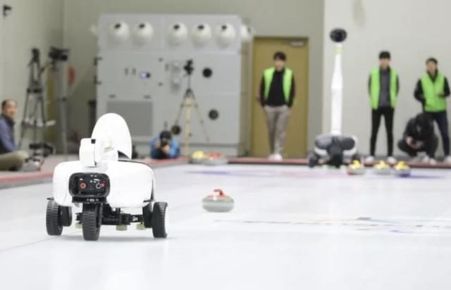 Curly versus an elite human curling team. (Image courtesy of Korea University.)