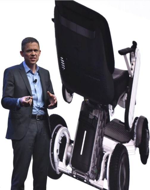 Stephen Hooper, VP and general manager of Fusion 360 products at Autodesk, shows a generative design part being used in production of the Whill wheelchair at Autodesk University 2018. (Picture courtesy of Autodesk.)