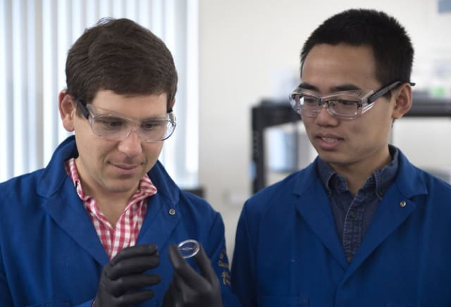UCI engineering professor Alon Gorodetsky and doctoral student Chengyi Xu have invented a new stretchy material modeled after both squid skin and Hollywood dinosaurs that has remarkable properties. (Image courtesy of UCI.)
