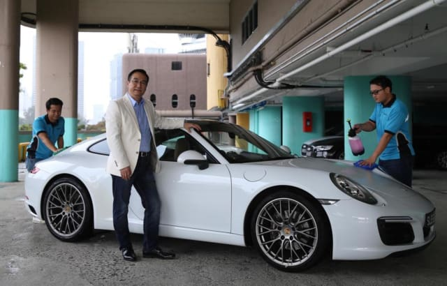 Dr. Joseph Sun developed a waterless car wash solution and created EWash, an app-based mobile car washing service in Singapore. (Image courtesy of Najeer Yusof/TODAY.)