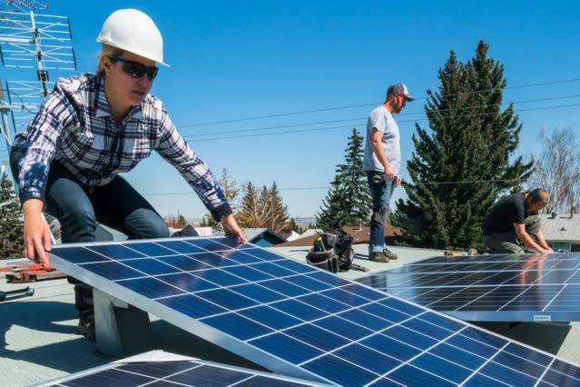 Installing solar panels. (Image courtesy of MIT.)