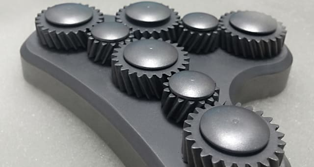 A metal 3D-printed part made by NPJ. NPJ is capable of producing interlocking, moving parts such as this in one print job. (Image courtesy of XJet.)