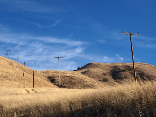 The golden hills of Chatsworth, Calif., featureranch grasslands and telephone poles. Power lines have sparked many a fire from the dry heat of summer, turning grass into fuel.