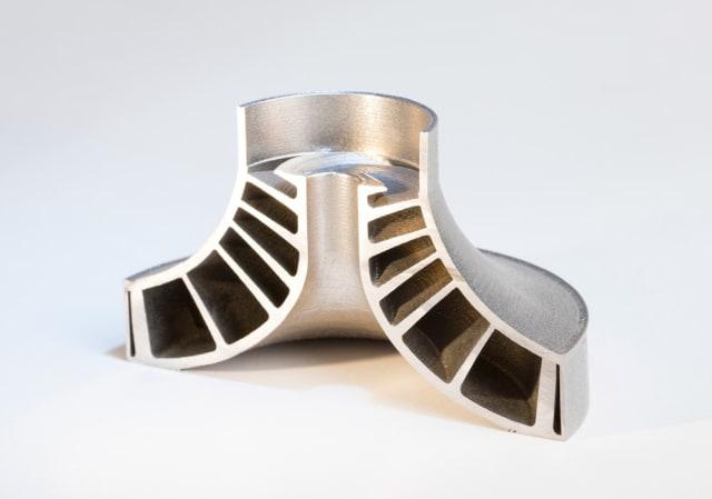 This part has not been post-processed. A shrouded impeller that was 3D printed using Velo3D's technology. These low angles are impossible without support structures using traditional PBF processes. (Image courtesy of Velo3D.)