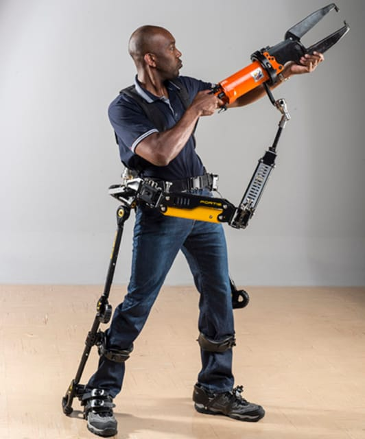 The Lockheed Martin Fortis, which has undergone numerous redesigns, is a passive exoskeleton that increases strength and provides stability using human-guided flexion and locking mechanisms. It is ergonomically designed to move naturally with the body and adapts to different body types and heights. (Image courtesy of Lockheed Martin.)