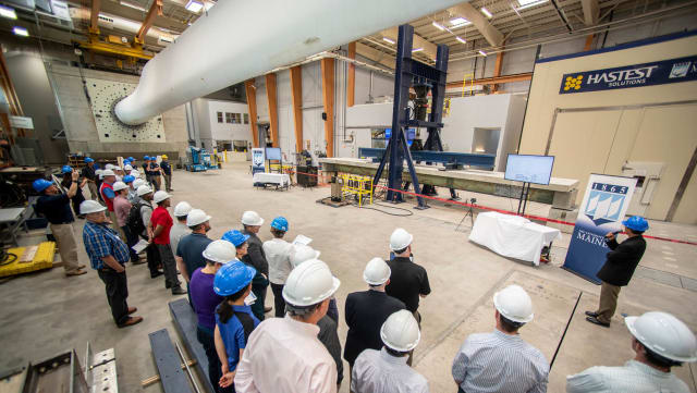 The University of Maine's Advanced Structures and Composites Center tests the strength of their new composite girders at a ceremony on July 12th. (Image courtesy of University of Maine.)