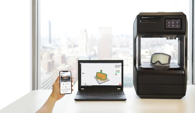 The new MakerBot Method 3D printer, alongside the MakerBot Mobile app. (Image courtesy of MakerBot.)
