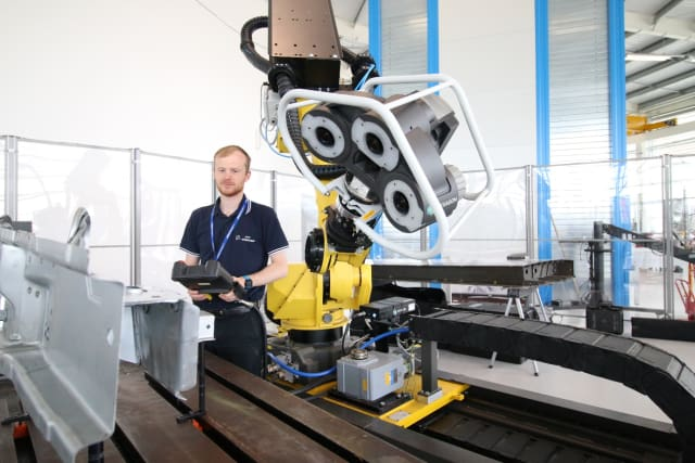 Thomas Hodgson, large volume metrology technical lead for the AMRC Integrated Manufacturing Group, puts the Hexagon Blaze 600A through its paces at Factory 2050. (Image courtesy of the author.)