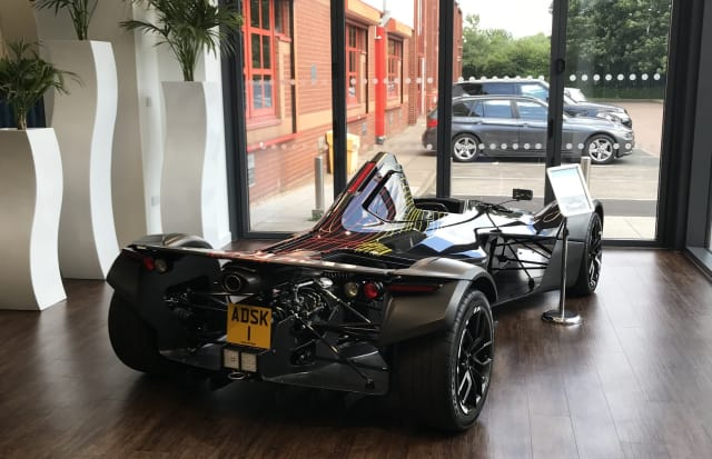 Autodesk purchased a single seat (when do you see that?) high performance sports car to dazzle visitors to their Birmingham tech center. No one is allowed to drive it. Not even press. We asked.
